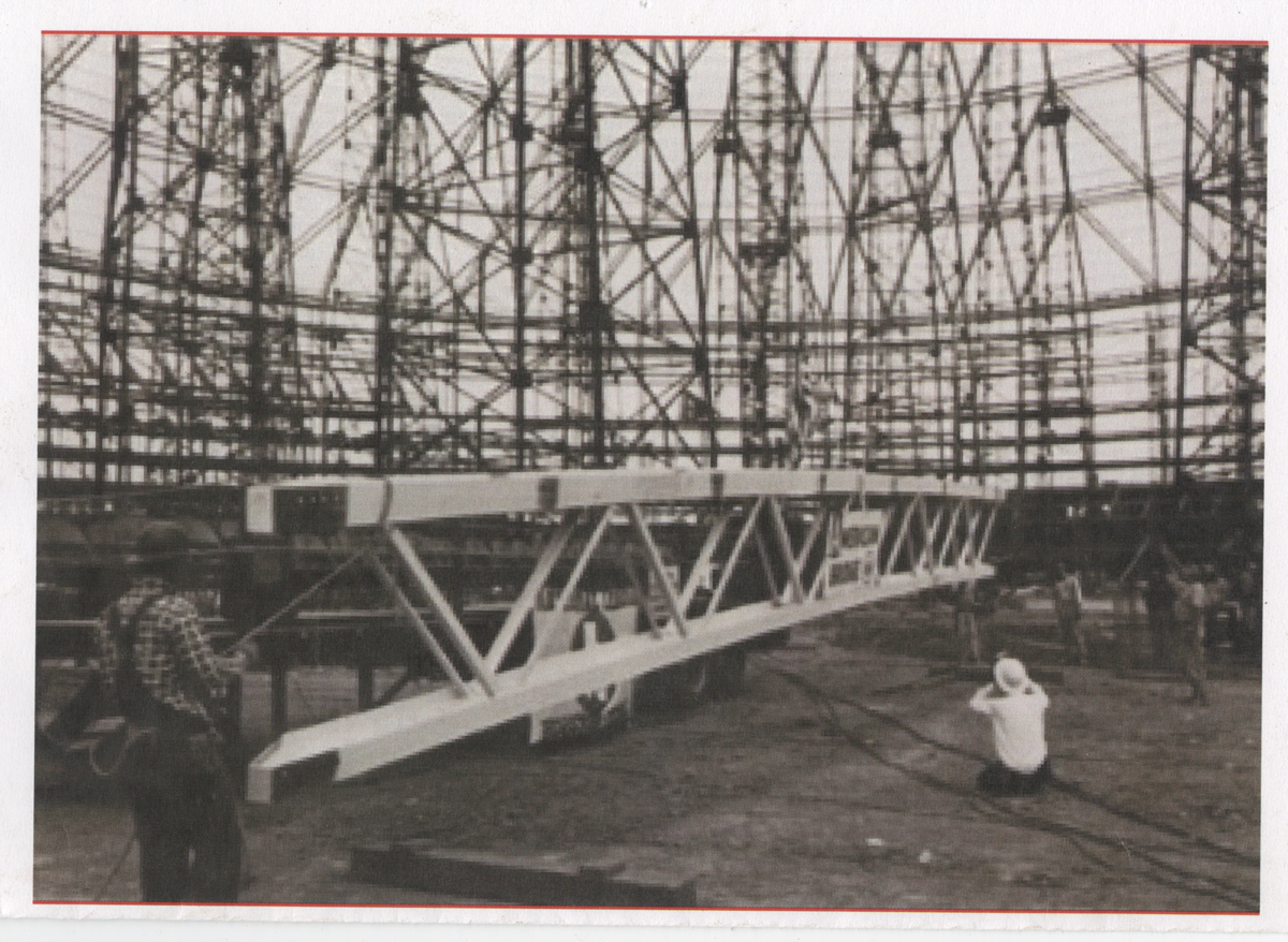 Harrel Crabb with the last beam during construction of the Astrodome