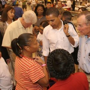Photograph, Former President Bill Clinton, Senator Barack Obama, and Former President George Herbert Walker Bush Visiting Katrina Evacuees at Reliant Arena