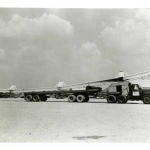 Photograph, Trucks Transporting Girders to the Astrodome, Image 2
