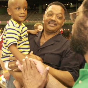 Photograph, Rev. Jesse Jackson Visiting Hurricane Katrina Evacuees at Reliant Astrodome