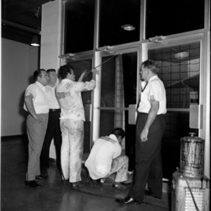 Workers tinting glass at Astrodome<br /><br />