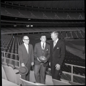Glen Dobbs, Bill Giles and an unidentified male at the Astrodome<br /><br />