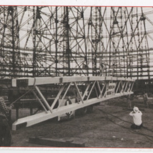Photograph, Harrel Crabb with the Last Beam During Construction of the Astrodome