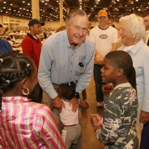 Photograph, Former President George Herbert Walker Bush and Barbara Bush Visiting Katrina Evacuees at Reliant Arena