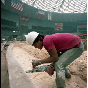 Worker replacing the Astrodome carpet