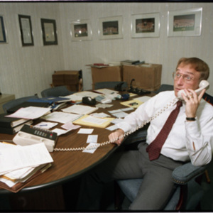 "Bill Woods, acting General Manager ""at work"" in his office"