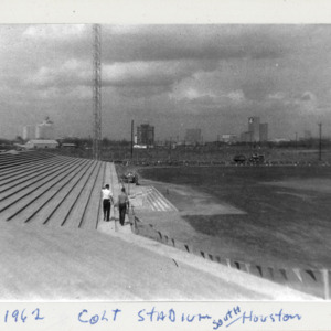 Photograph, Two Men Walking Along Aisle at Colt Stadium