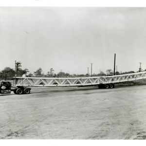 Photograph, Trucks Transporting Girders to the Astrodome, Image 1