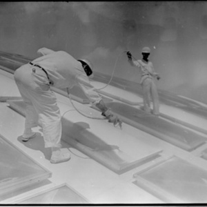Workers on the roof of the Astrodome<br /><br />