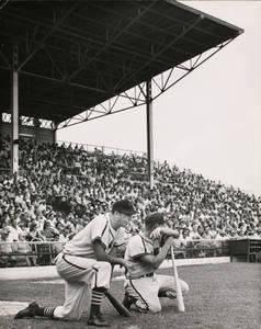 HPL-Harry_Walker_manager_Houston_Buffs_baseball_team_kneeling_beside_unidentified_player.jpg